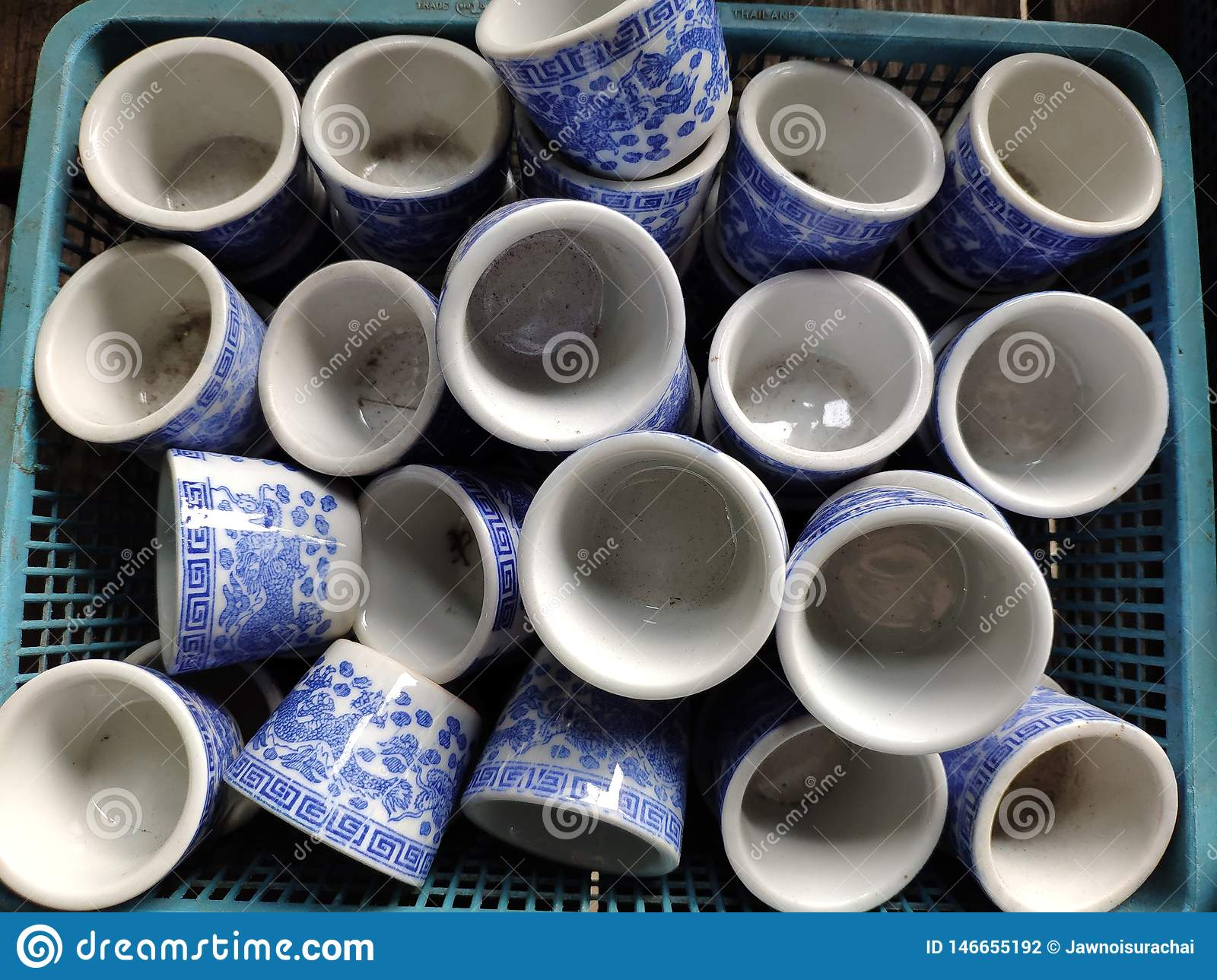 Chinese style cups used for drinking tea Placed on the blue basket.