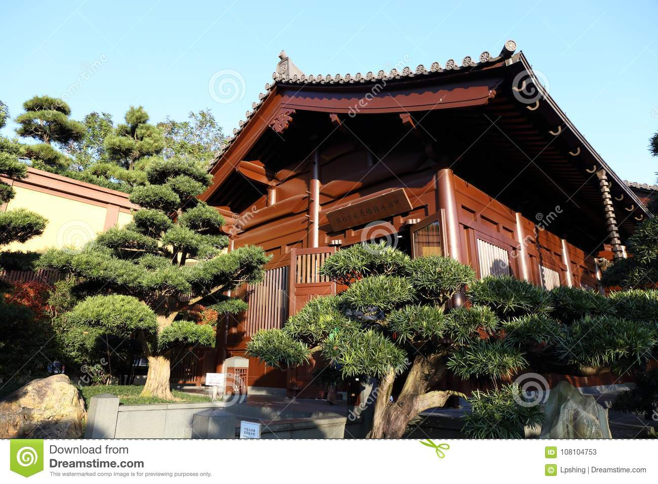 Asian Chinese Style Garden With Tree, Gardening, House, Water, Bridge ,  Stone, Design, Architecture Can Be Found In China, Asia.