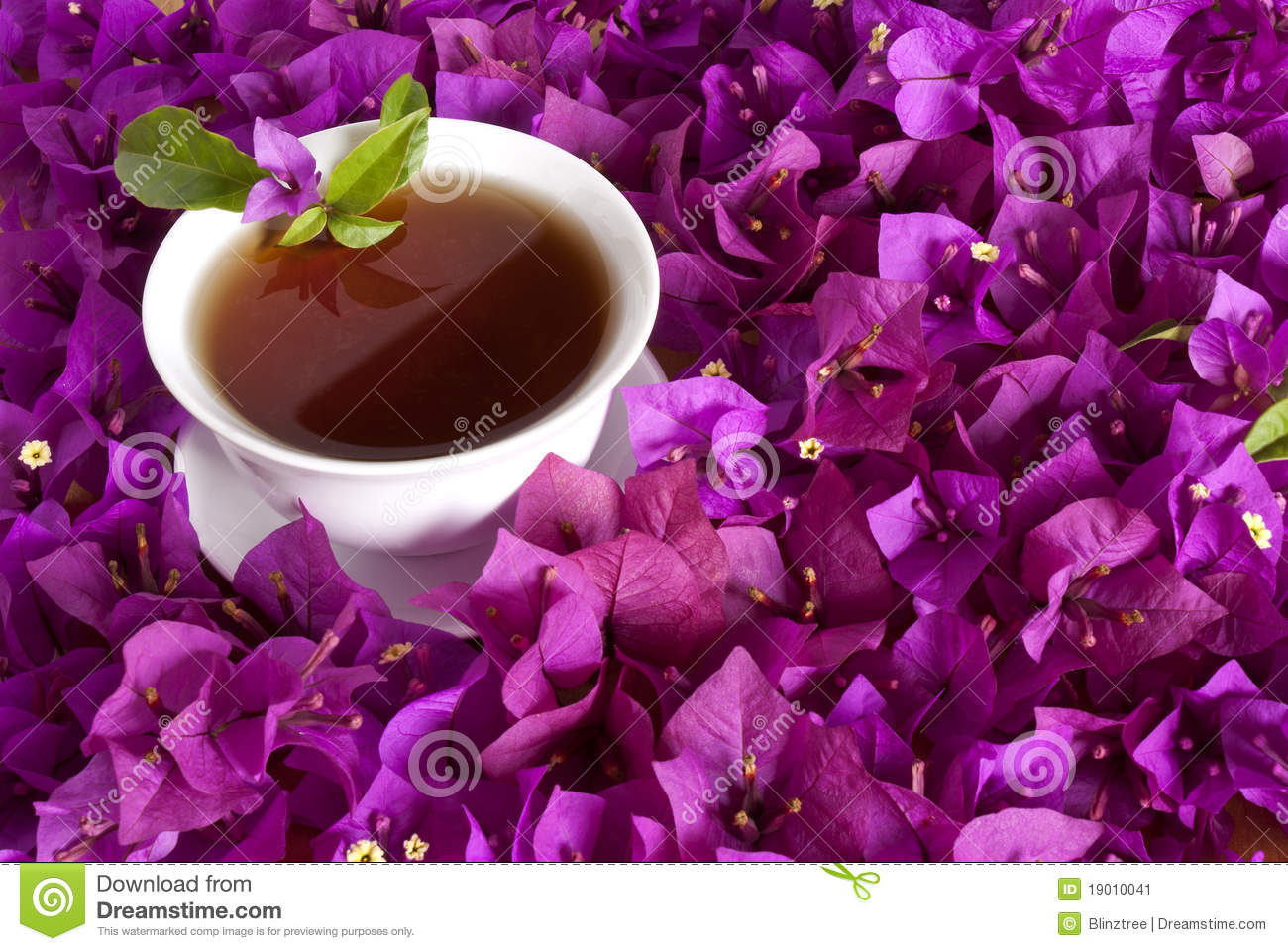 Chinese Tea surrounded by flowers