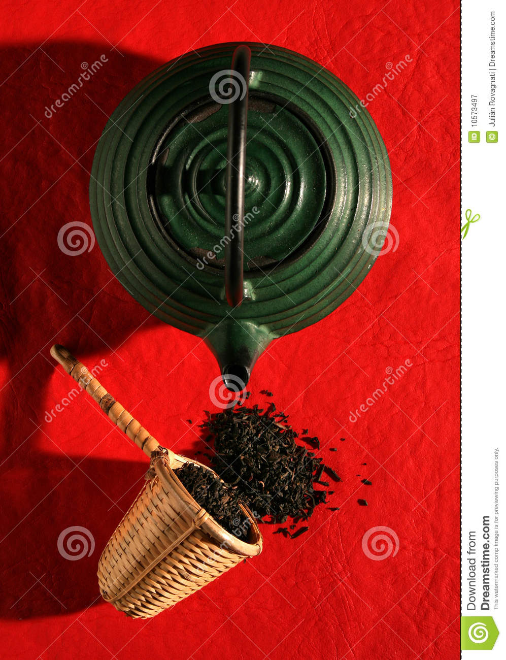 Chinese teapot and a wicker scoop