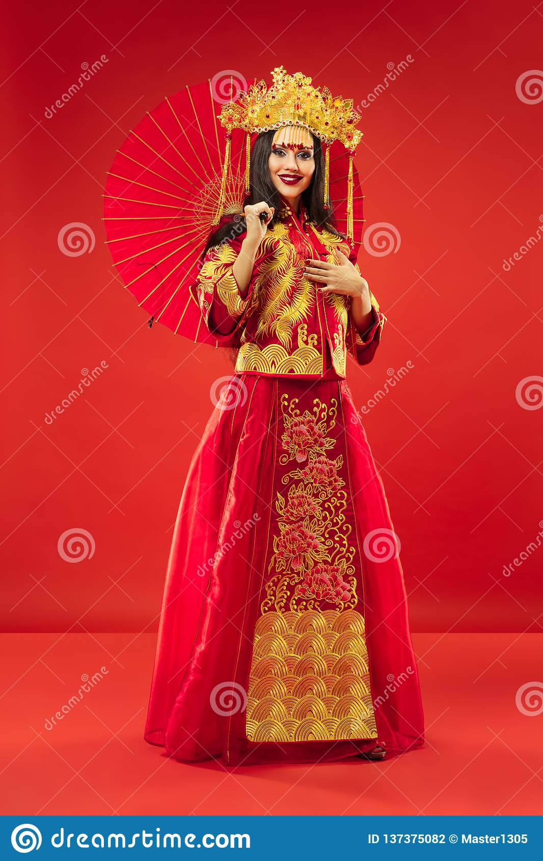 Chinese traditional woman. Beautiful young girl wearing in national costume