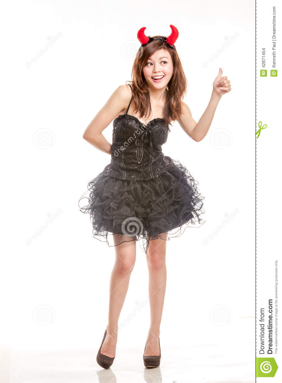 chinese woman in black dress and devil horns with stock photo