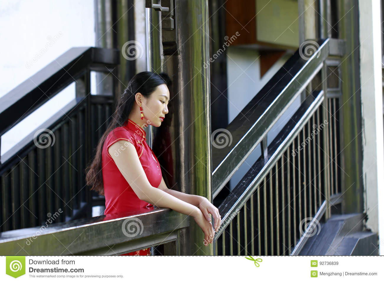Chinese Woman In Cheongsam Stand In Wooden Stairs In Mudu