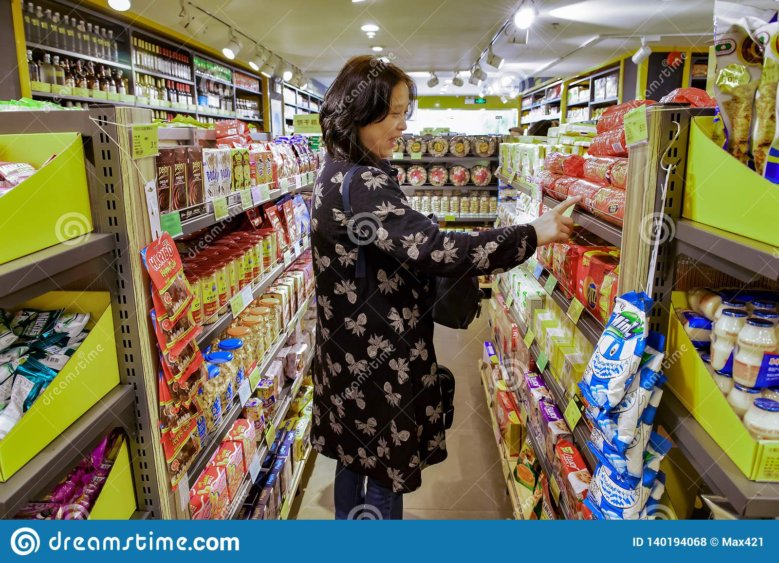 A Chinese woman is delighted to find her favorite biscuits. Shenzhen