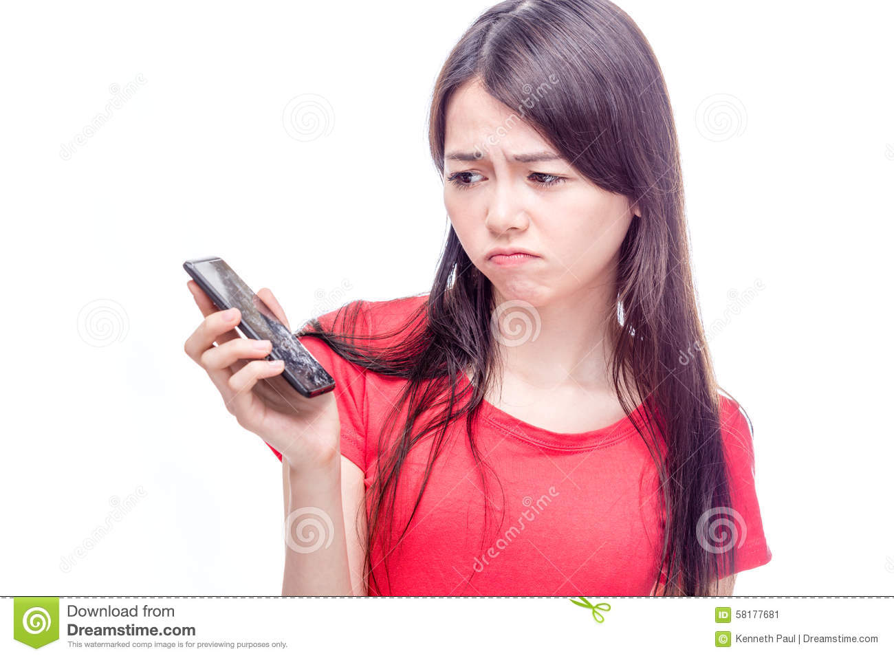 Chinese woman frowning at broken cell phone