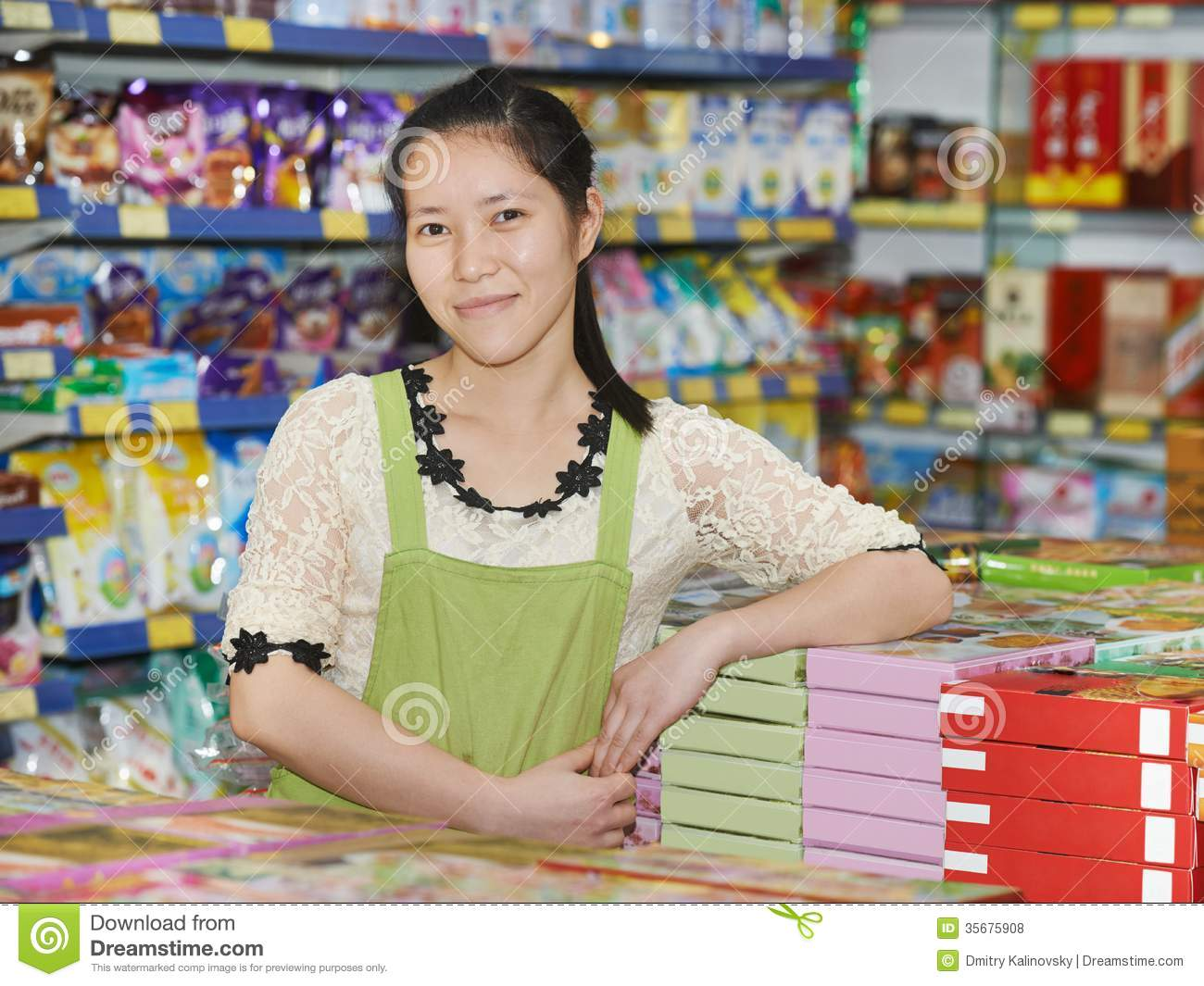 Chinese Woman Seller In Shop Royalty Free Stock Photos