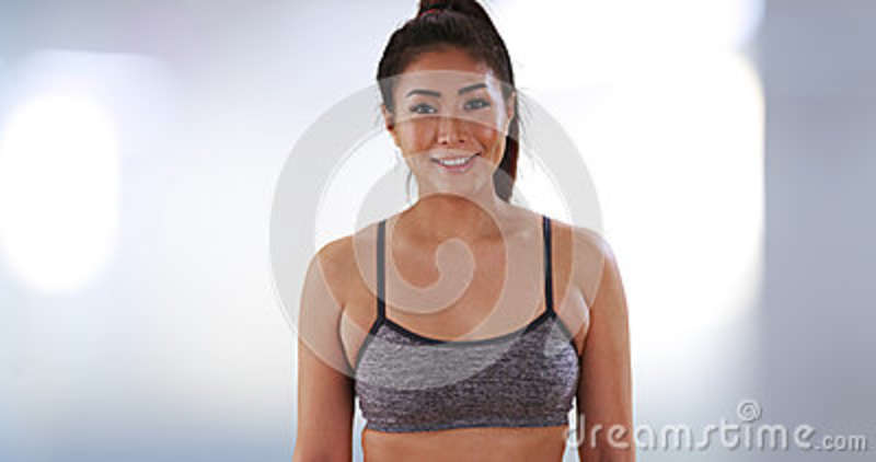 Chinese woman standing at the gym