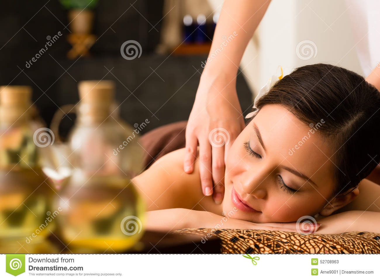 chinese woman at wellness massage with essential oils stock image