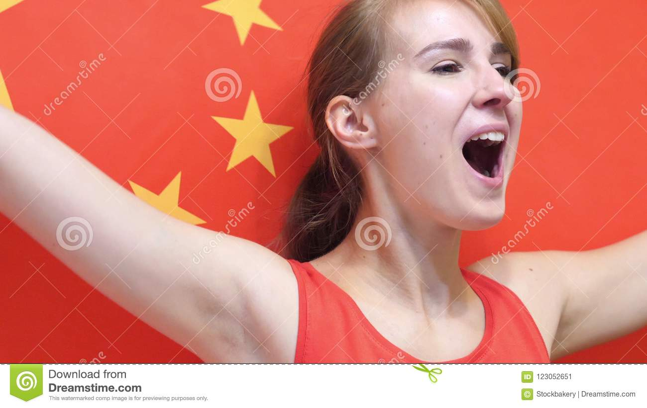Chinese Young Woman Celebrates holding the Flag of China in Slow Motion