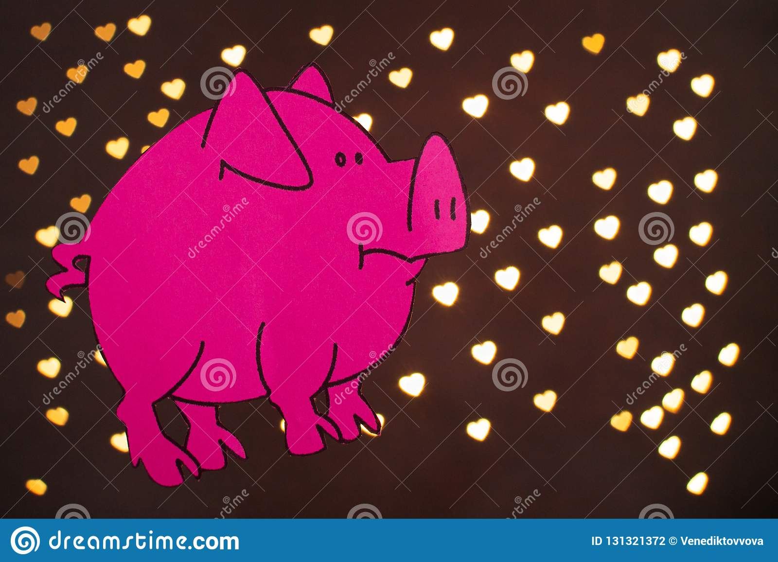 Chinese Zodiac Sign Year of Pig, Pink paper cut pig,Happy New Year 2019 year. on black background with beautiful bokeh