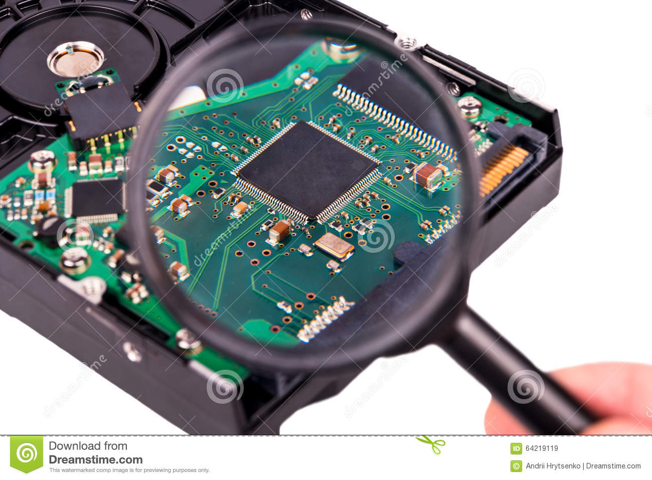 Glass Hard Drive : Chip under magnifying glass stock photo image