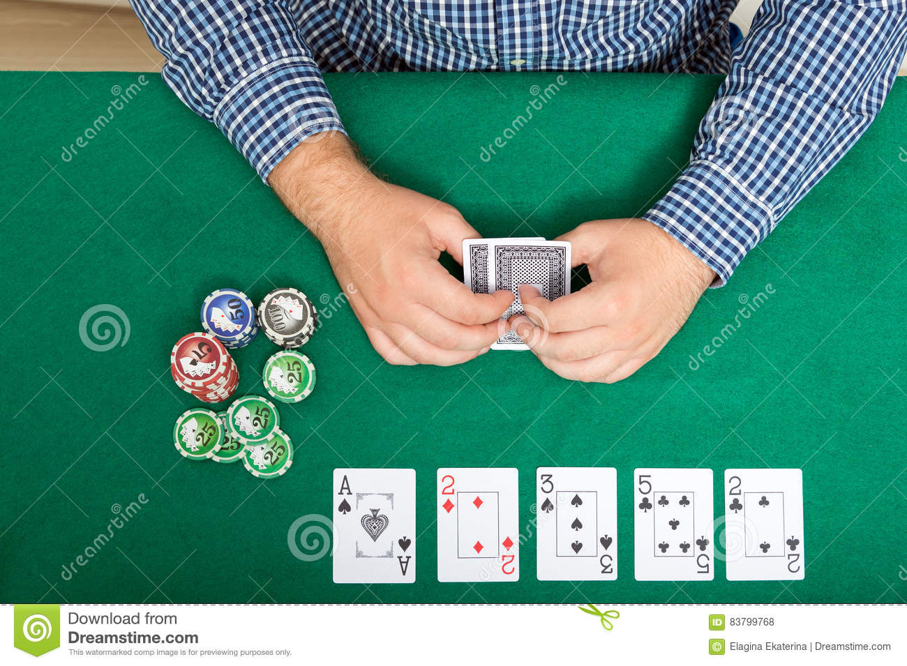 Download Chips And Cards For Poker In Hand On Green Table, Top View Stock  Photo