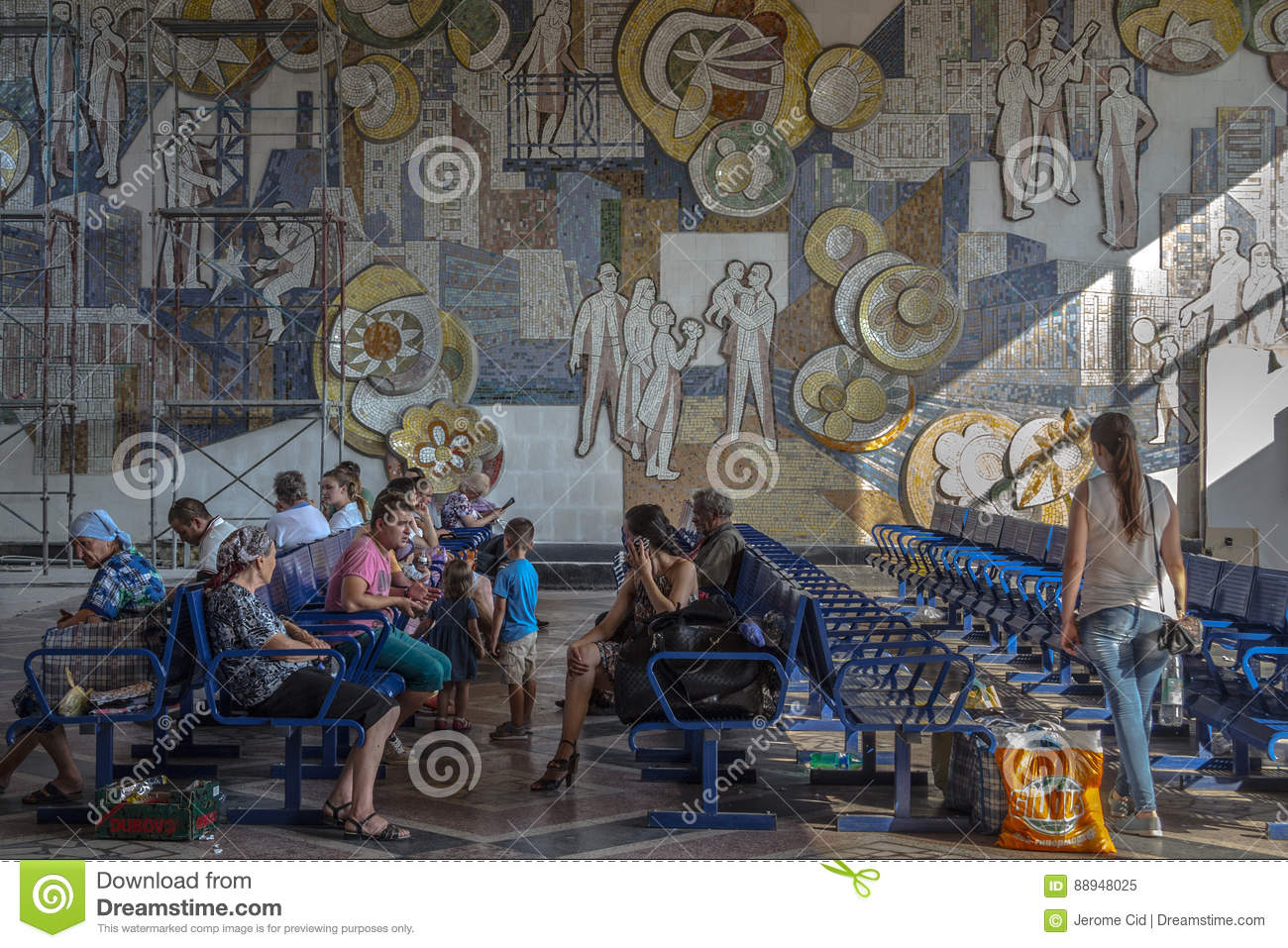CHISINAU, MOLDOVA - AUGUST 11, 2015: People sitting in the waiting room of the Chisinau bus station, waiting to board a bus