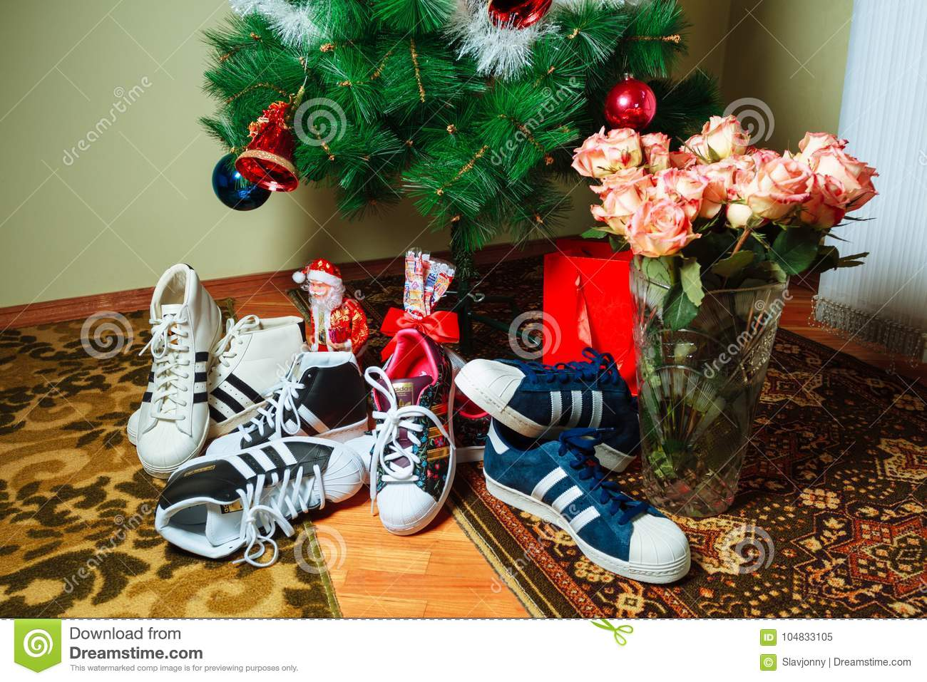 Despido Mm desagradable  Chisinau, Republic Of Moldova - January 04, 2016: Sneakers Superstar  Company Adidas On Background Of The Christmas Tree. Editorial Image - Image  of emblem, decoration: 104833105
