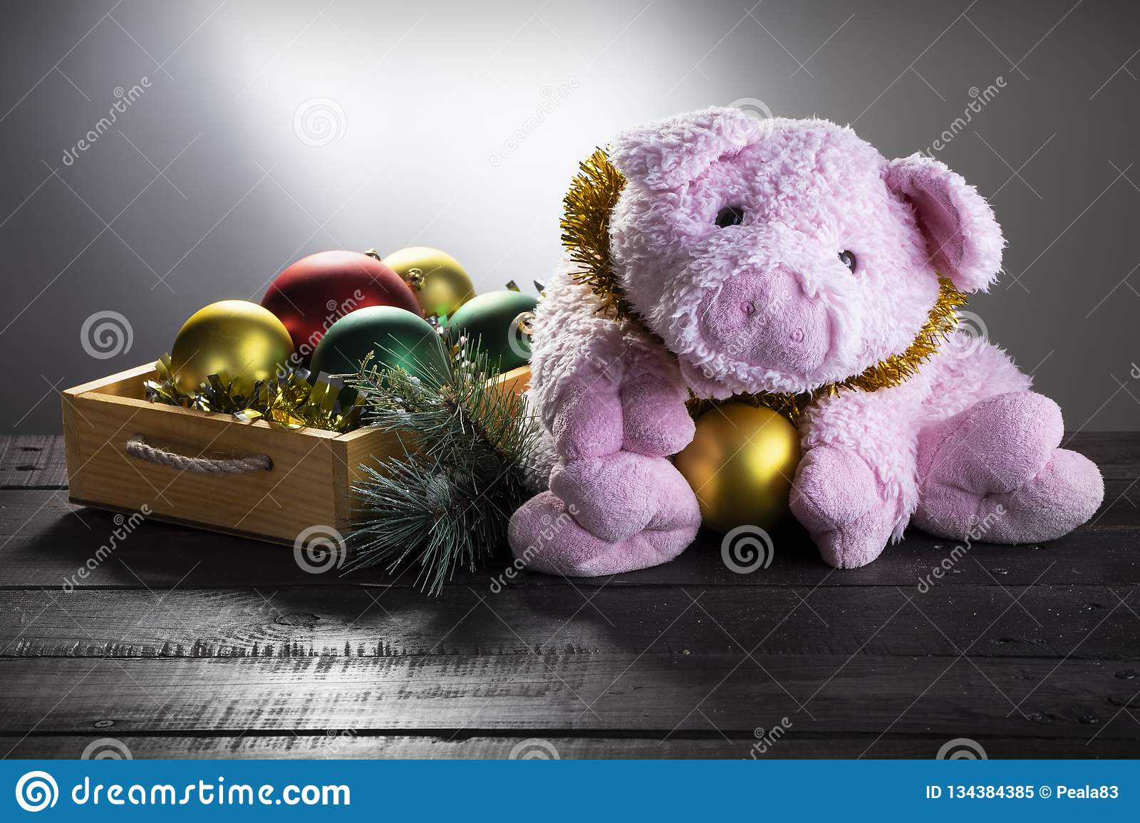 Chistmas background with toy pig and New year balls. Present card, New Year of Pig, Zodiac symbol 2019