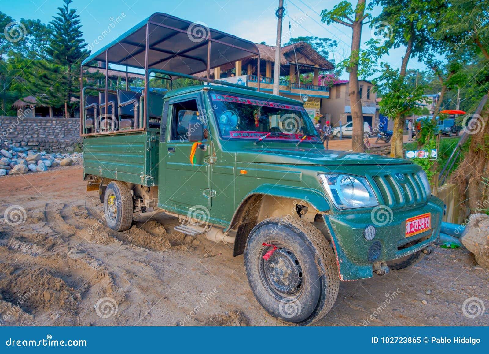 CHITWAN, NEPAL - NOVEMBER 03, 2017: Green Car Parked Waiting For