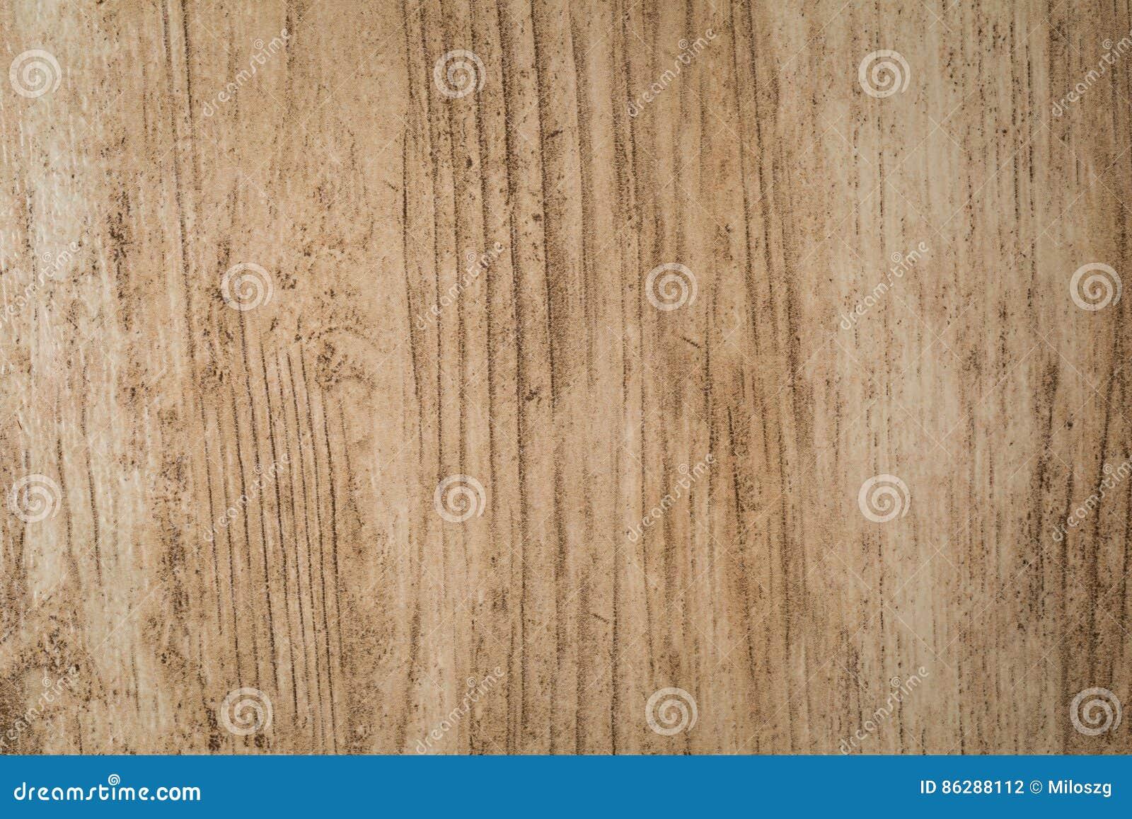Chiuda su della piastrella per pavimento del tipo di legno