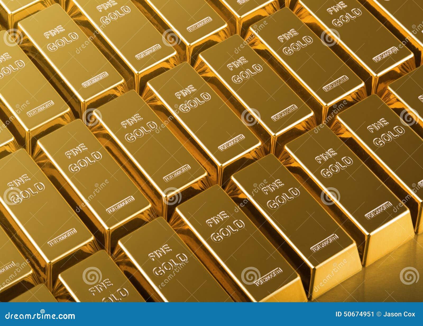 Chiuda su delle barre di oro
