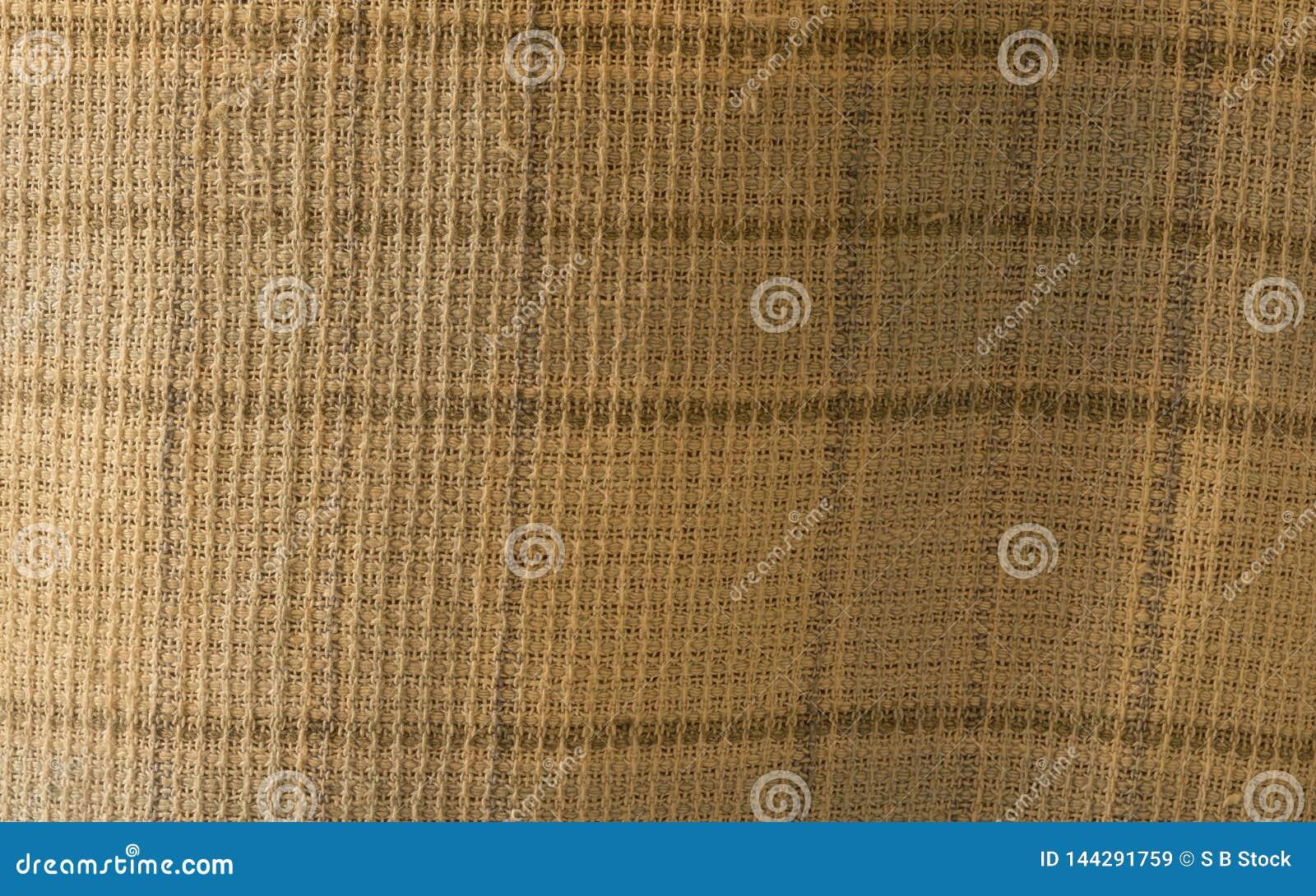 Chiuda su di struttura sgualcita del tessuto, fondo del tessuto del panno di tela di tessuto leggero con l onda incrociata Modell