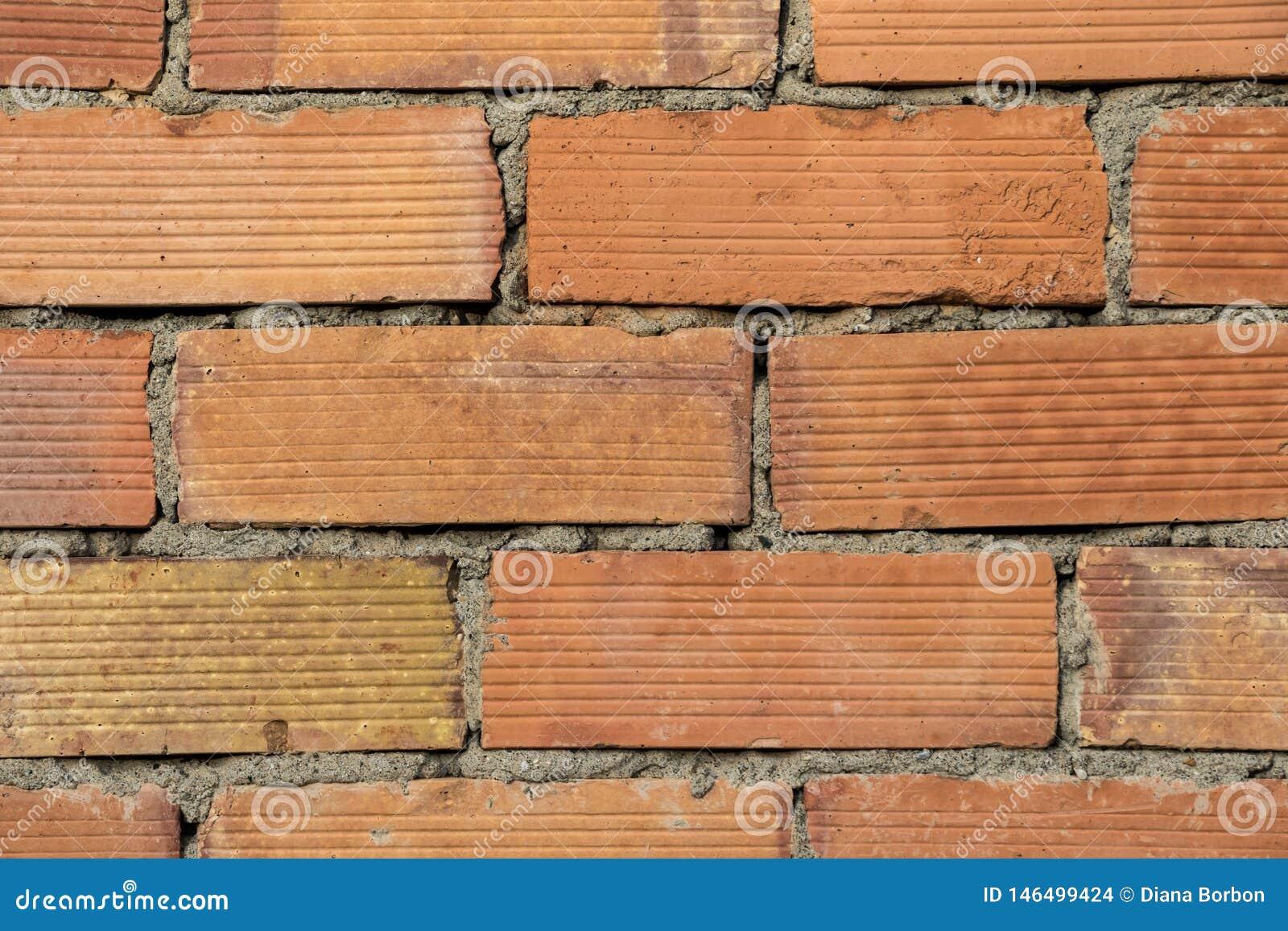 Chiuda su di vecchio fondo rosso di struttura del muro di mattoni