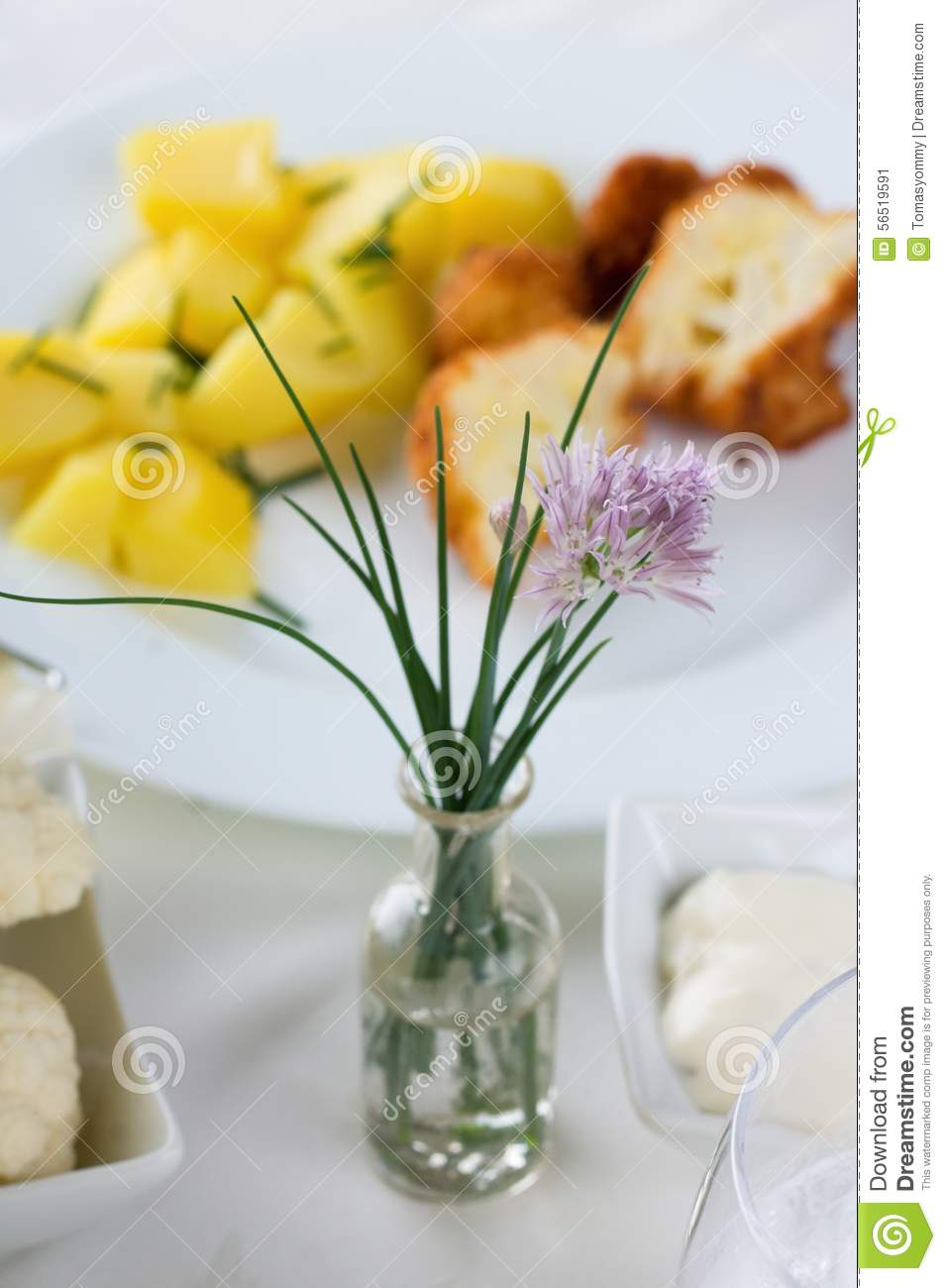chive with lila bloom on a table with lunch stock photo image 56519591. Black Bedroom Furniture Sets. Home Design Ideas