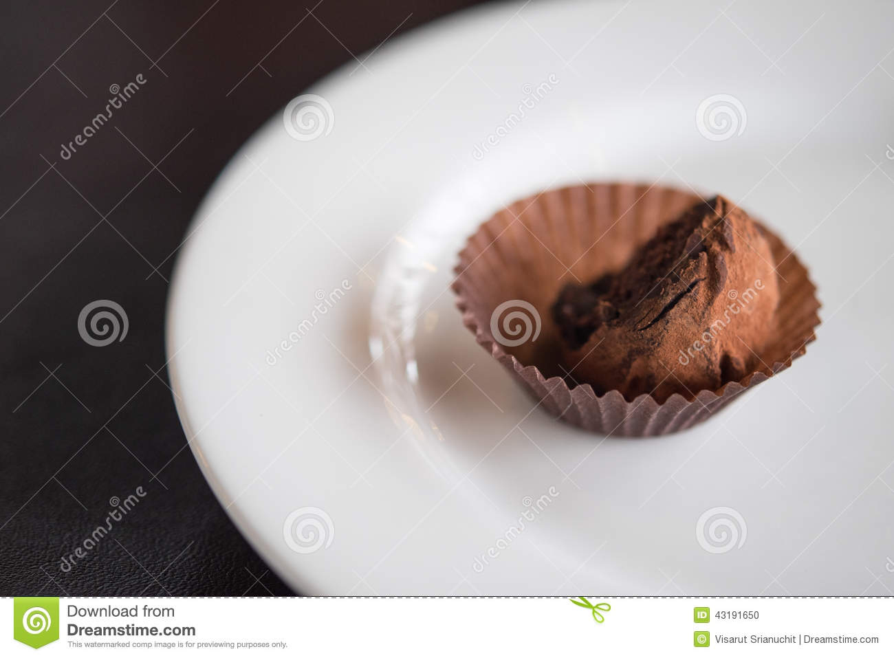 Chocolate ball on white plate