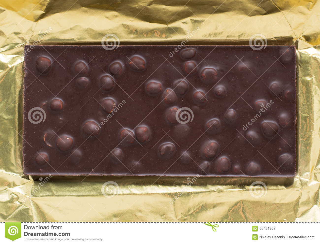 Chocolate Bar In Open Gold Foil Wrapping Stock Photo - Image: 65461907