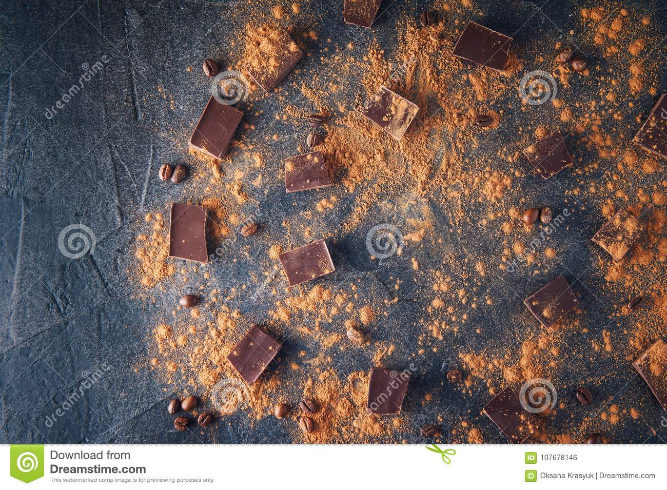 Chocolate bar pieces, cocoa powder and coffee beans on dark stone background. Background with chocolate. Slices of chocolate. Swee