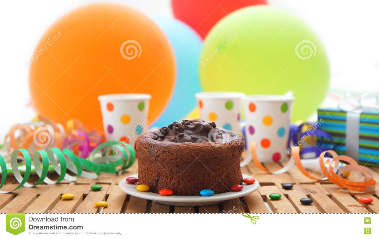 Chocolate Birthday Cake On Rustic Wooden Table With Background Of Colorful Balloons Gifts Plastic