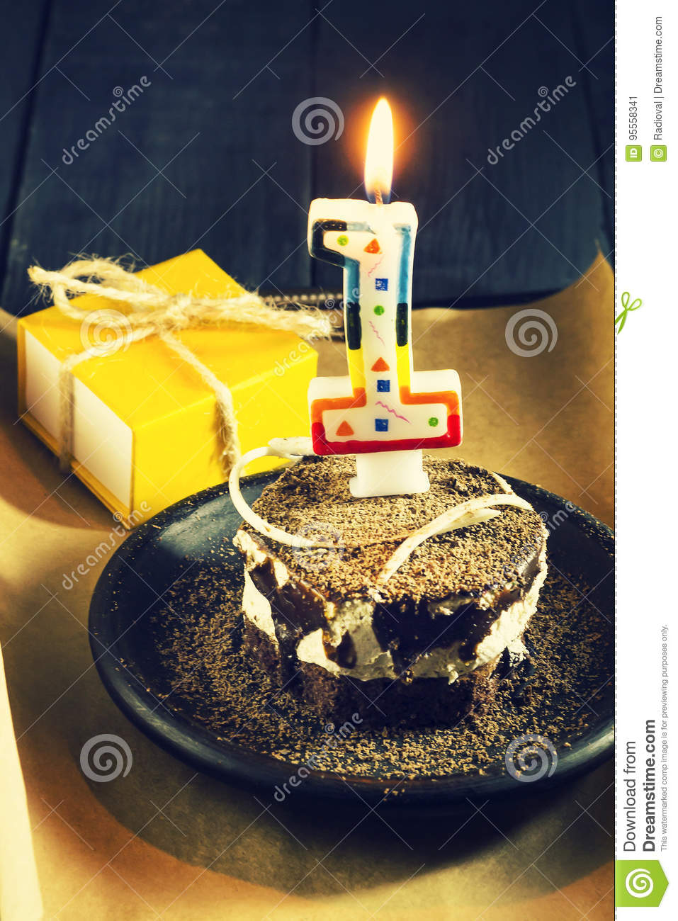 Chocolate Cake With A Candle And Giftshappy Birthday Card