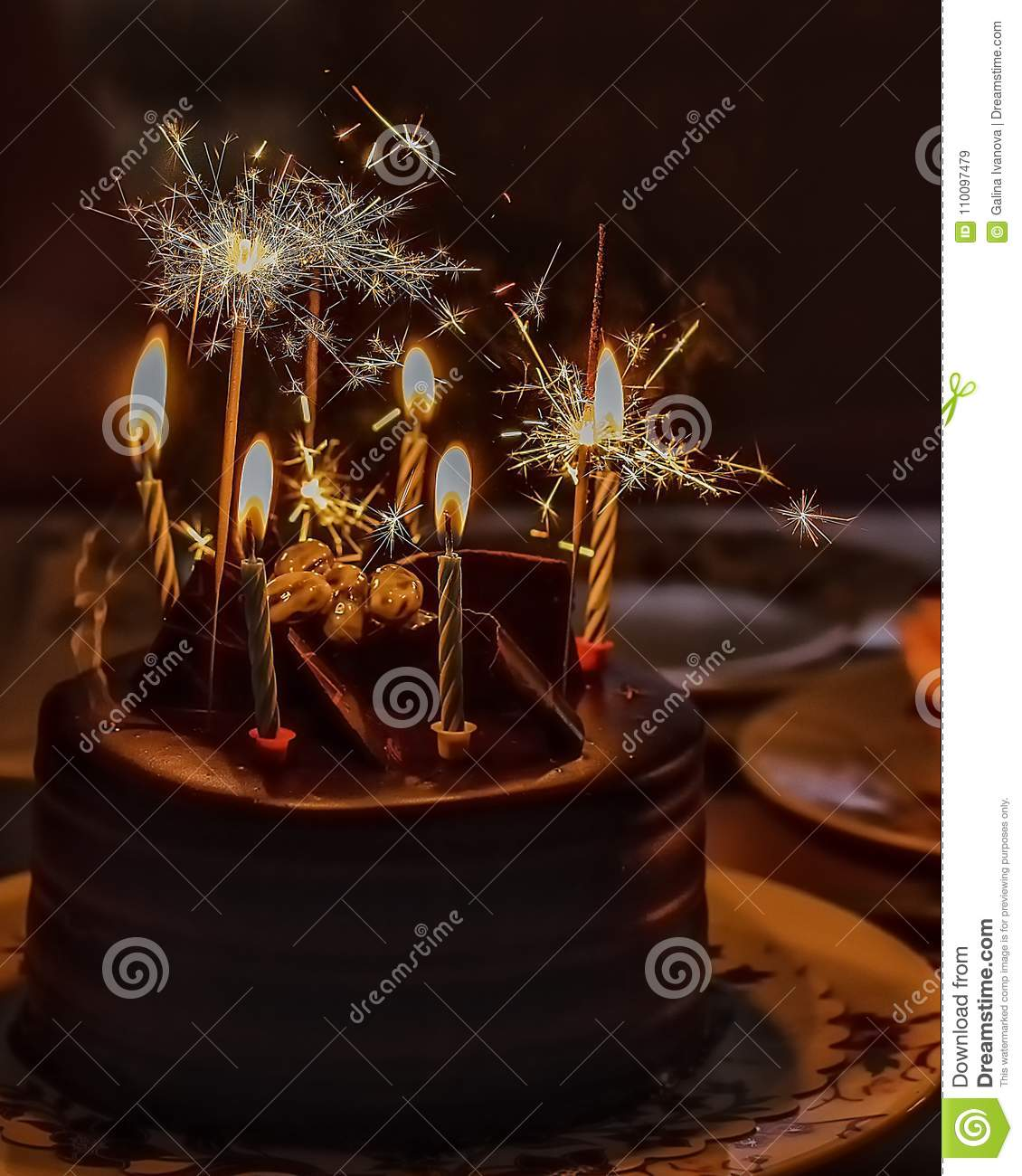 Chocolate Cake With Candles And Sparkling Light For Birthday