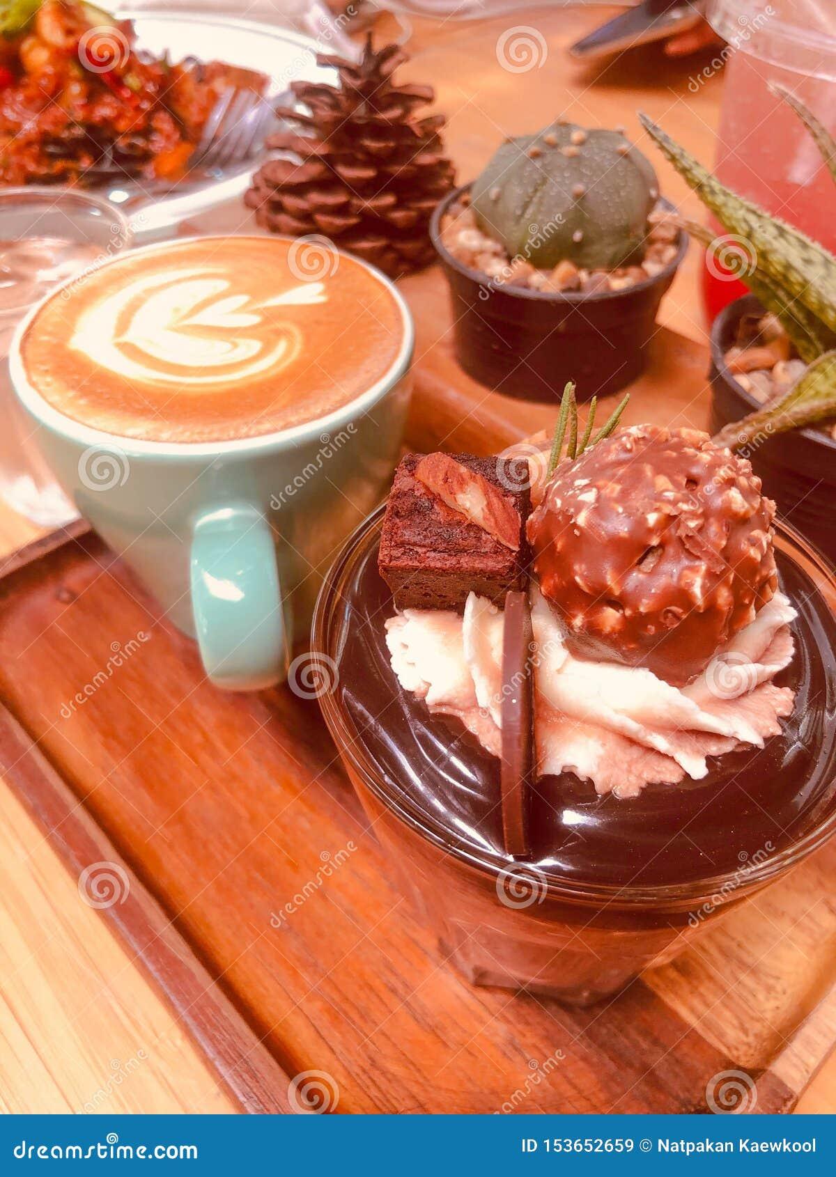 Chocolate cake and cappuccino coffee