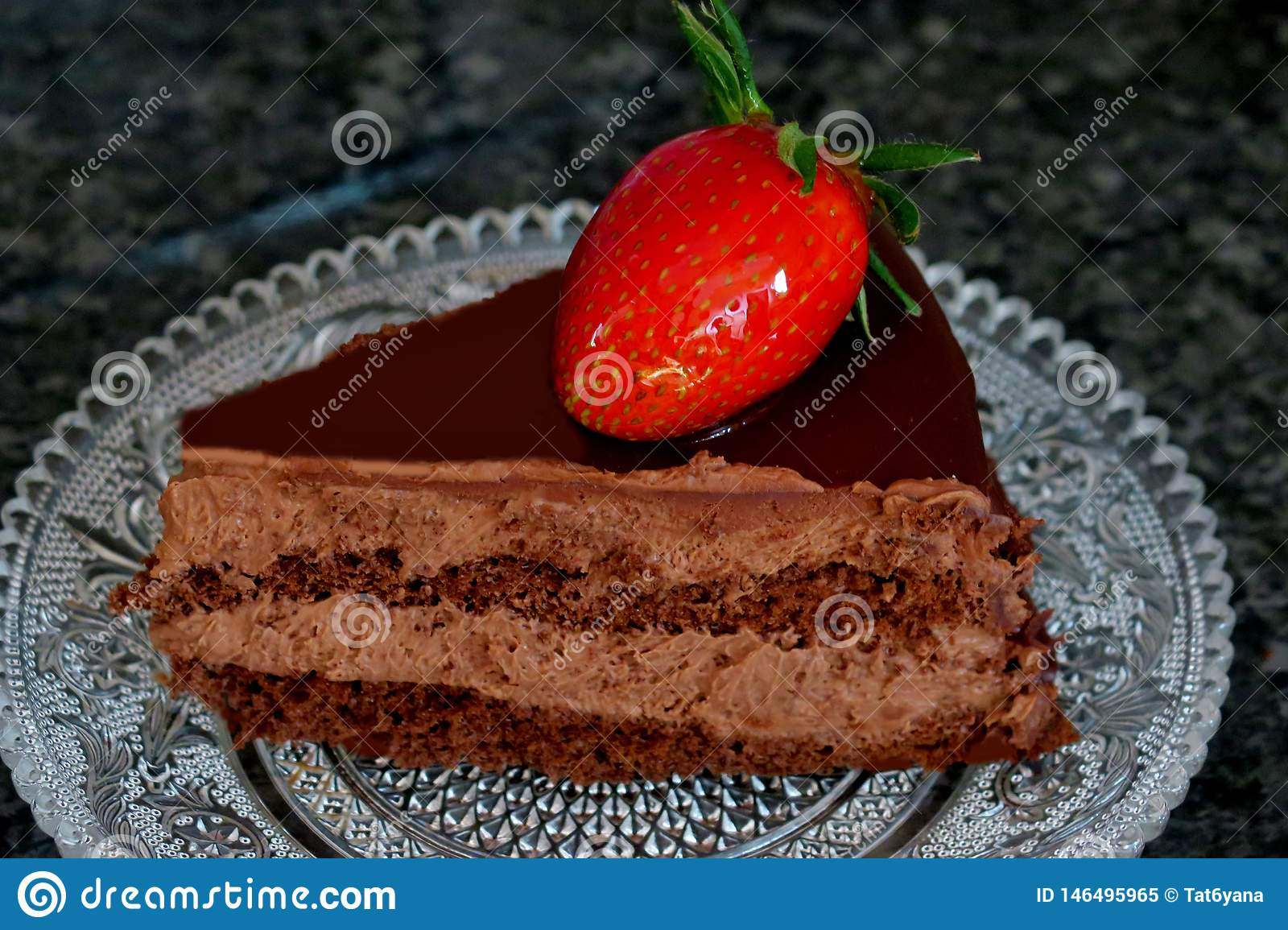 Chocolate cake with cocoa cream and strawberries