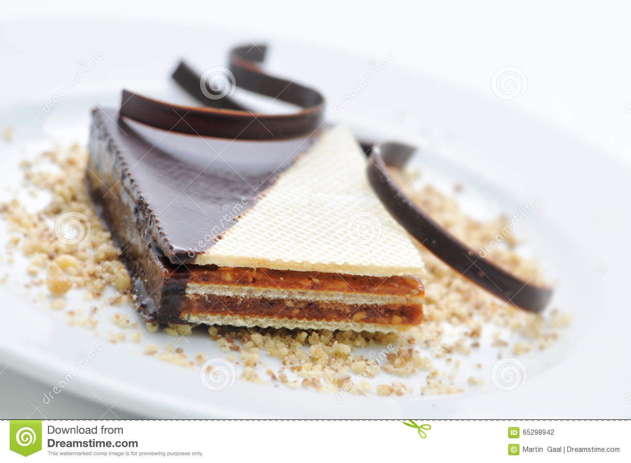 chocolate cake with coffee beans on white plate sweet dessert patisserie shop cocoa powder