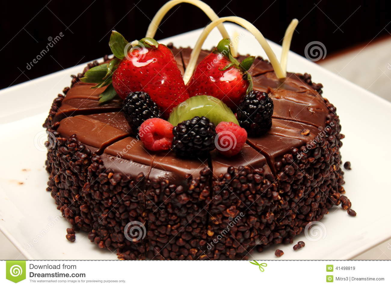 Chocolate cake with fresh fruit decoration stock image for Decoration avec des roses