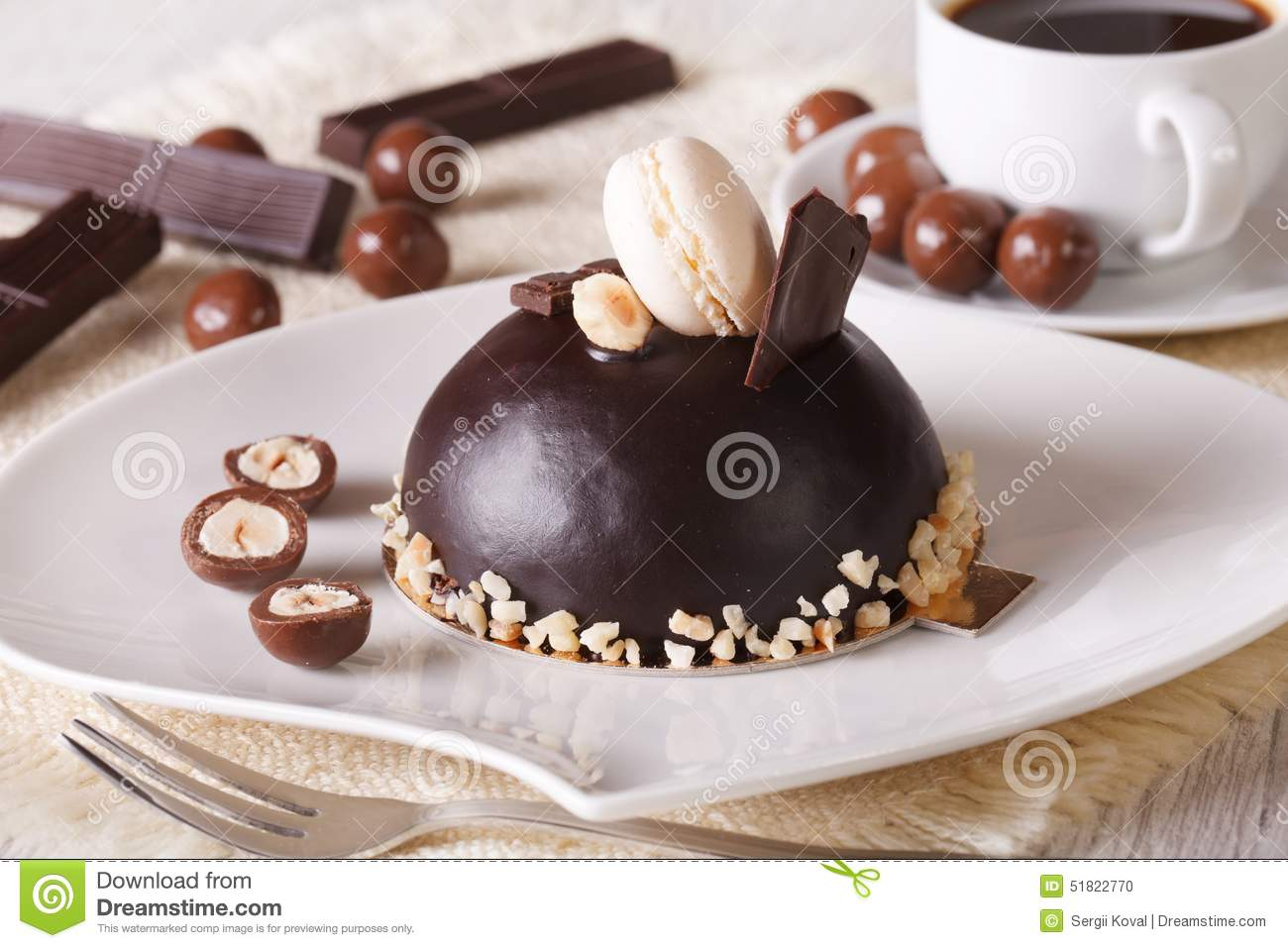 Chocolate Cake With Nuts, Macaroon On A Plate And Coffee ...