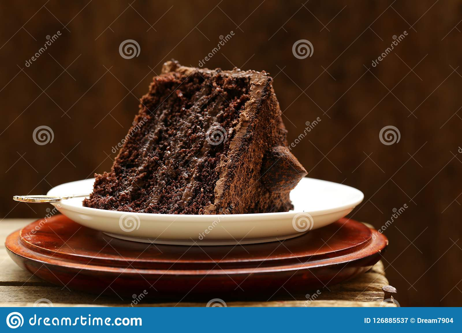 Chocolate cake on a plate. Piece of super chocolate cake on a plate Royalty Free Stock Photography
