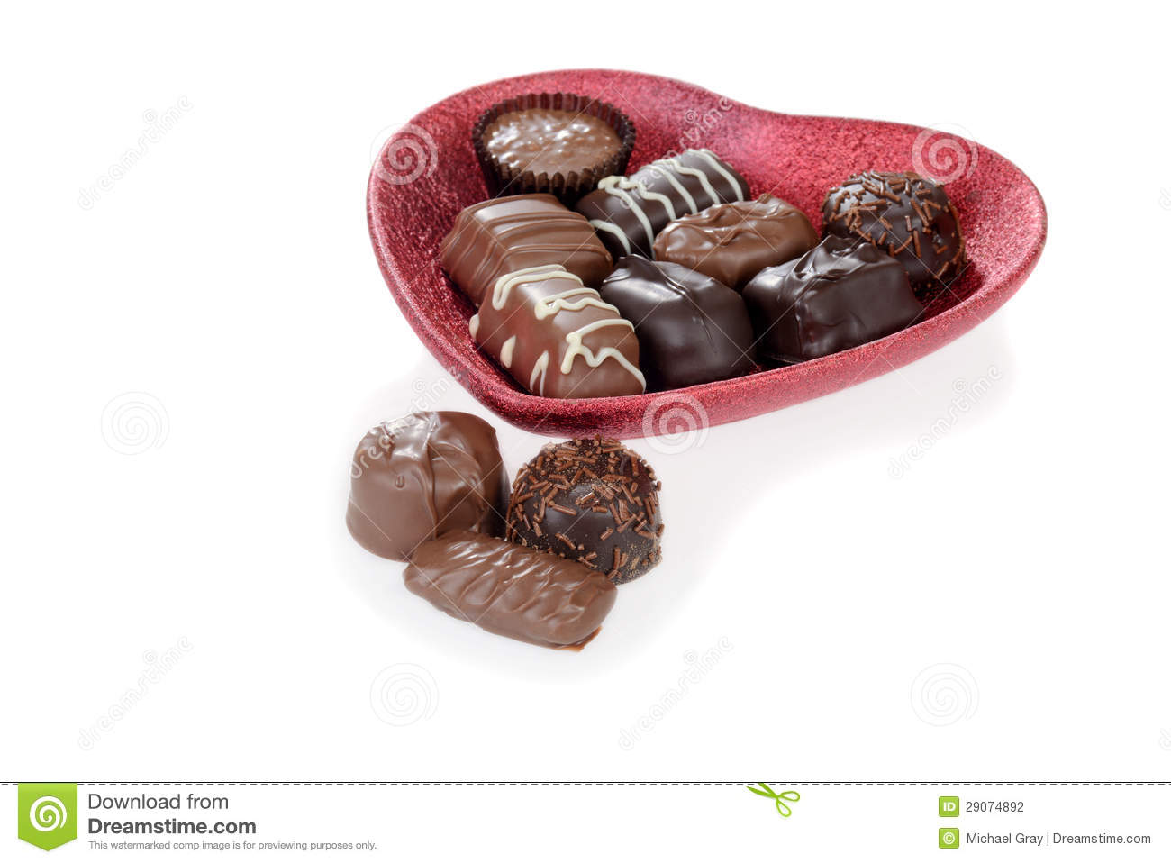 Chocolate candy in red heart bowl