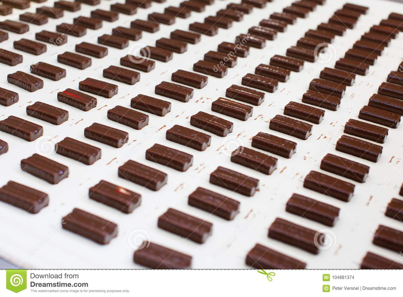 Chocolate covered candy at a candy factory.