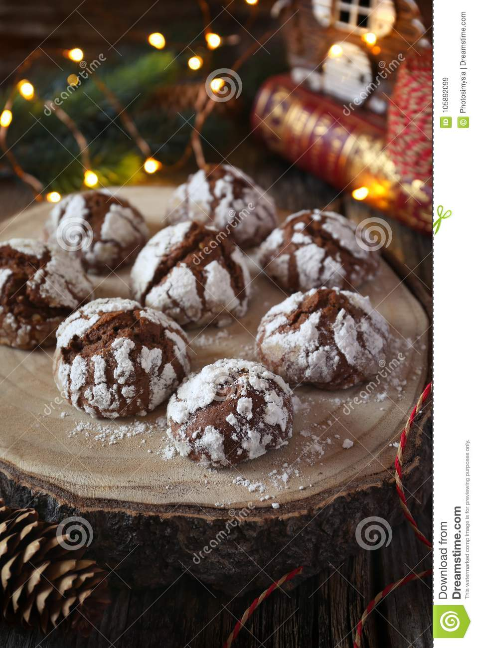 Chocolate Crinkle Cookies In Powdered Sugar And Christmas Decoration