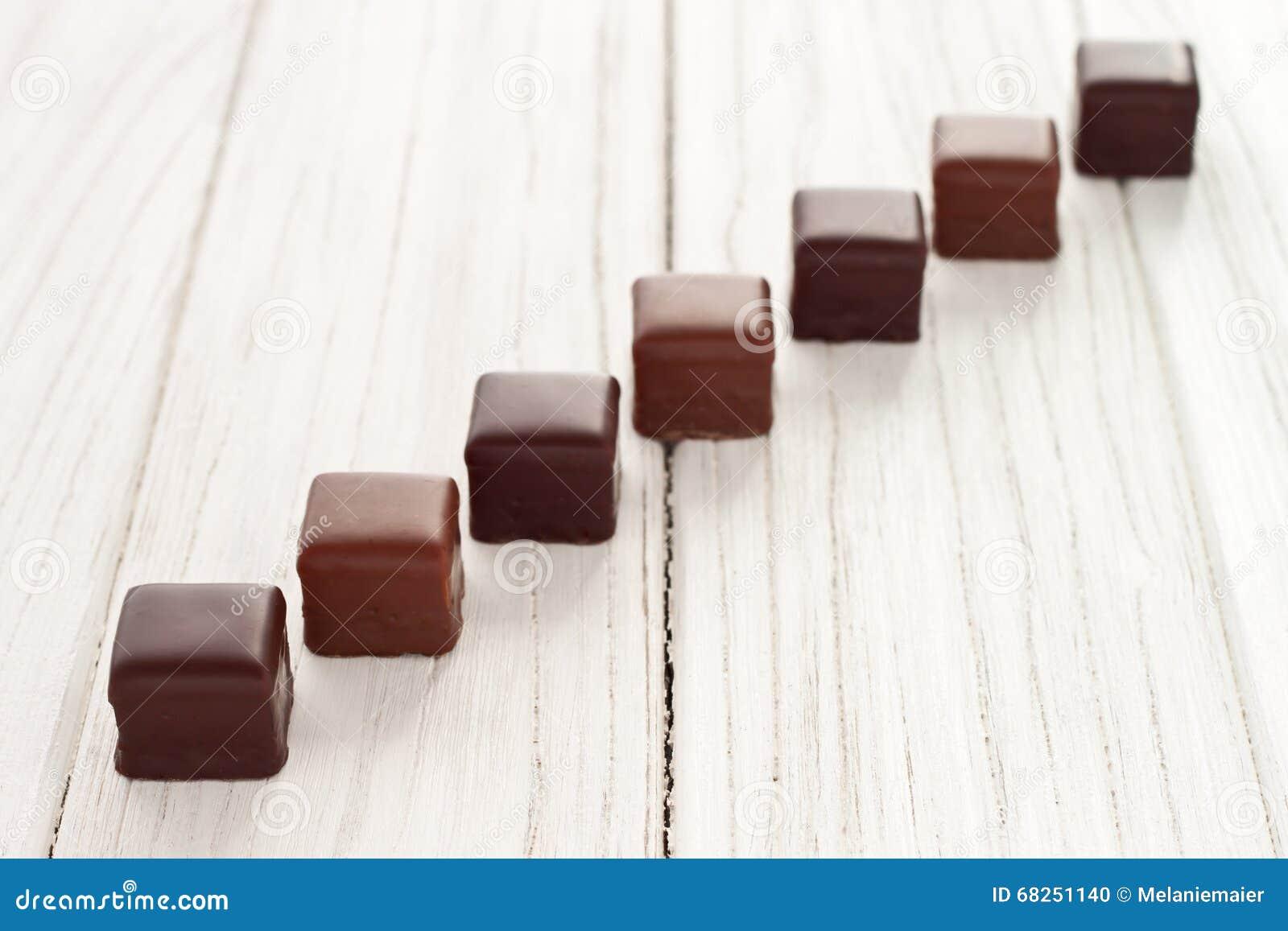 Chocolate dominos stock photo. Image of copy, chocolate - 68251140