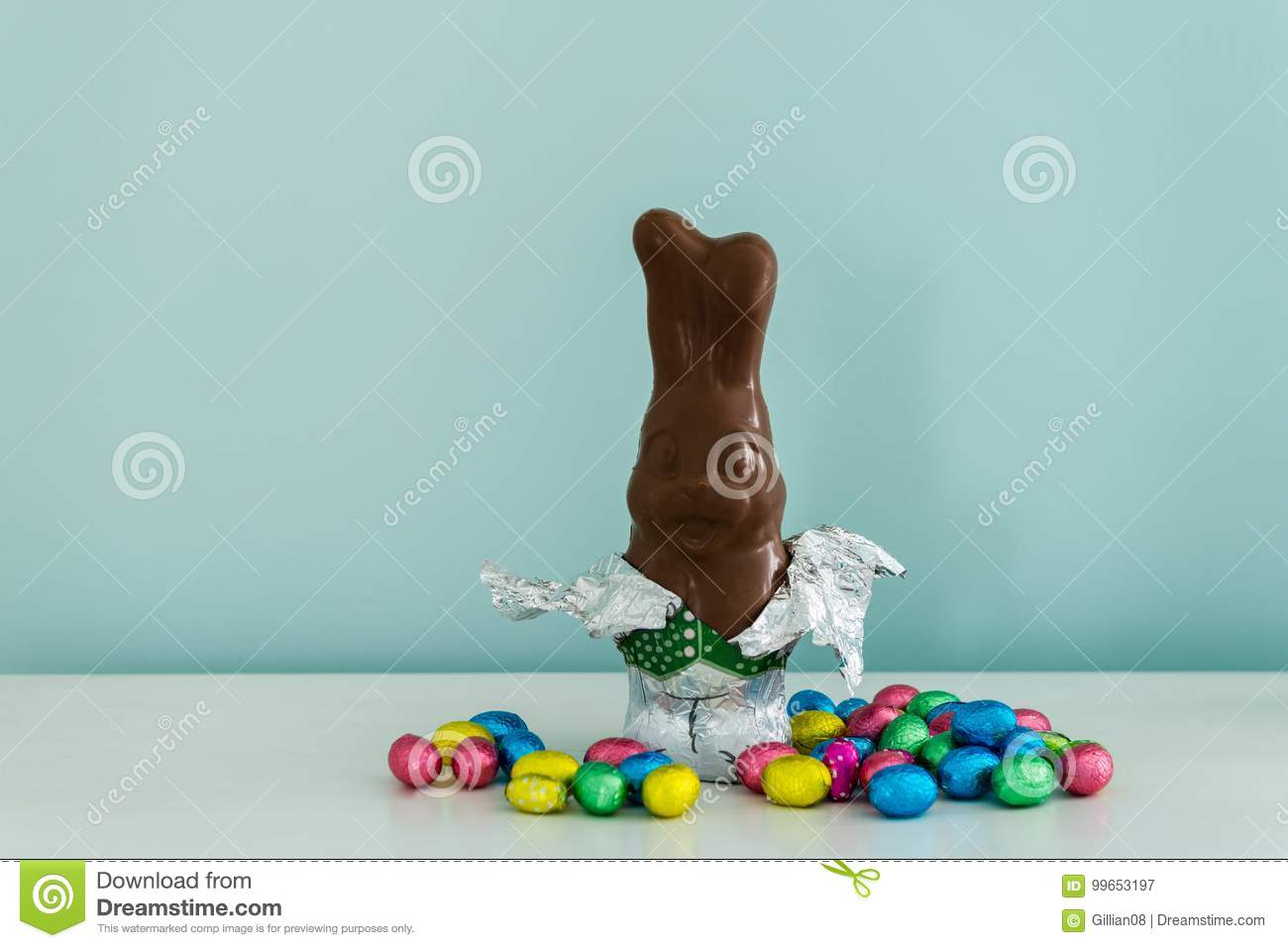 Chocolate easter bunny, half unwrapped
