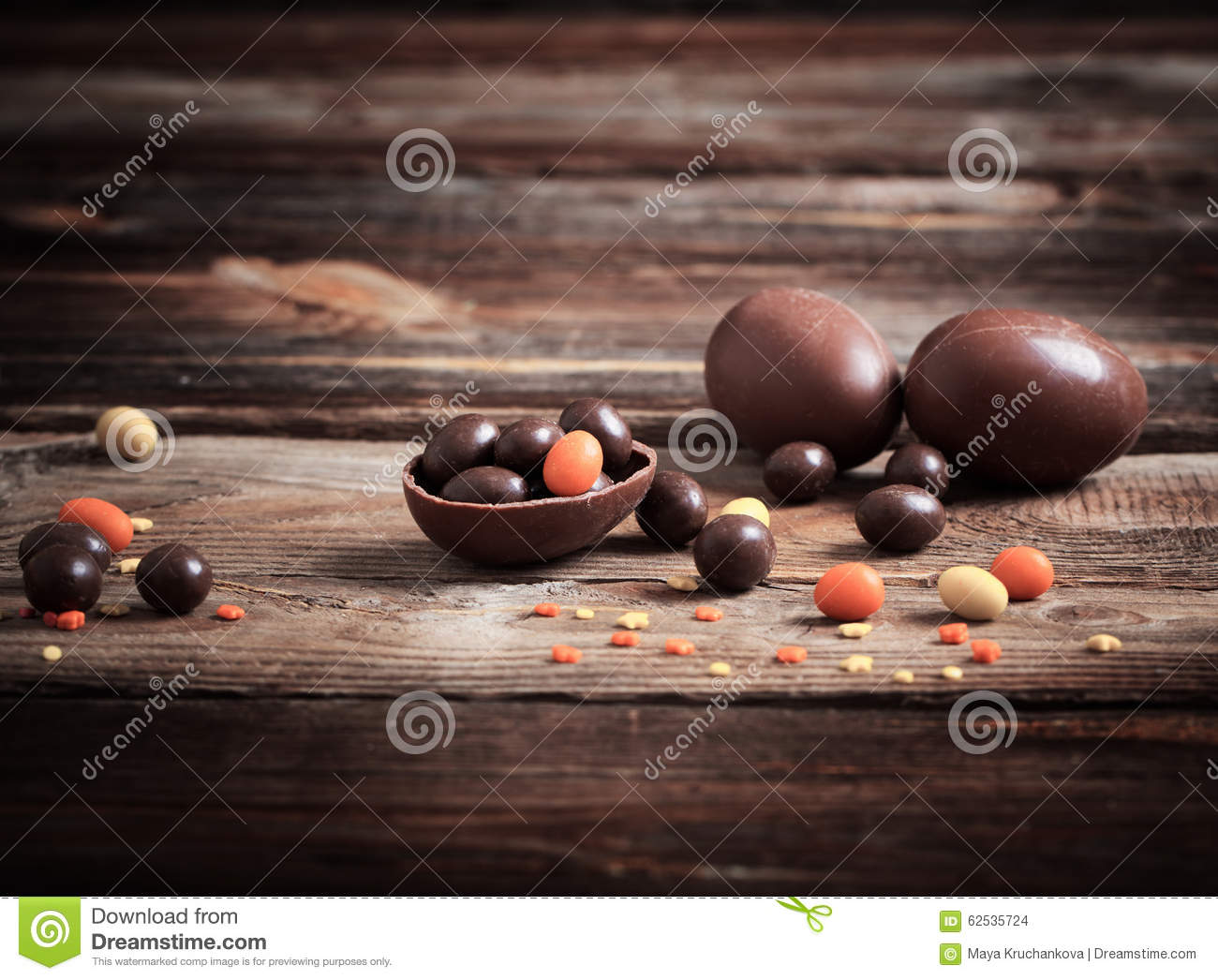 Chocolate Eggs Over Wooden Background