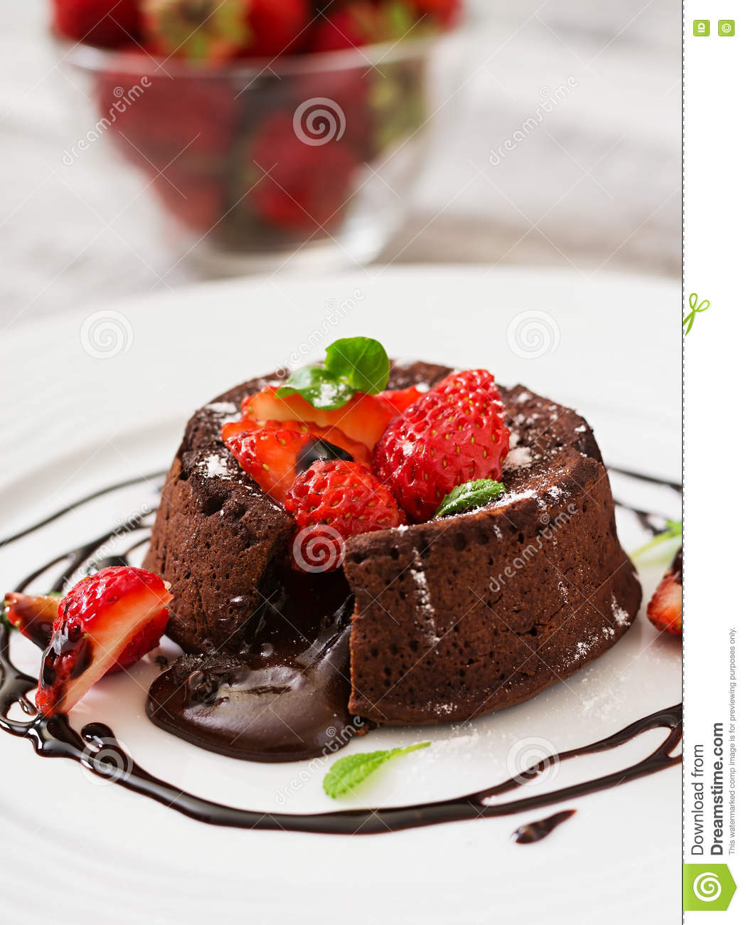 Chocolate fondant (cupcake) with strawberries