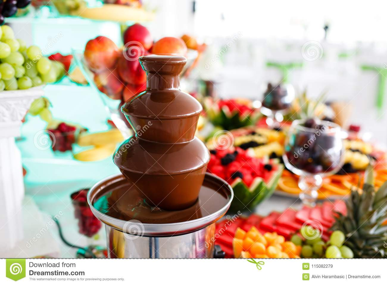 Chocolate Fountain And Fruits For Dessert At Wedding Table Stock