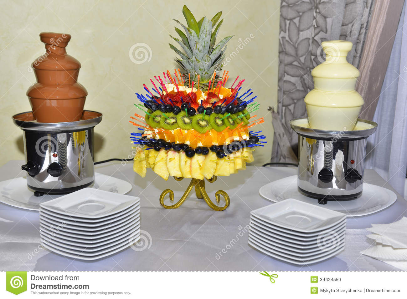 Chocolate Fountains With Fruits On The Table Stock Photo - Image ...