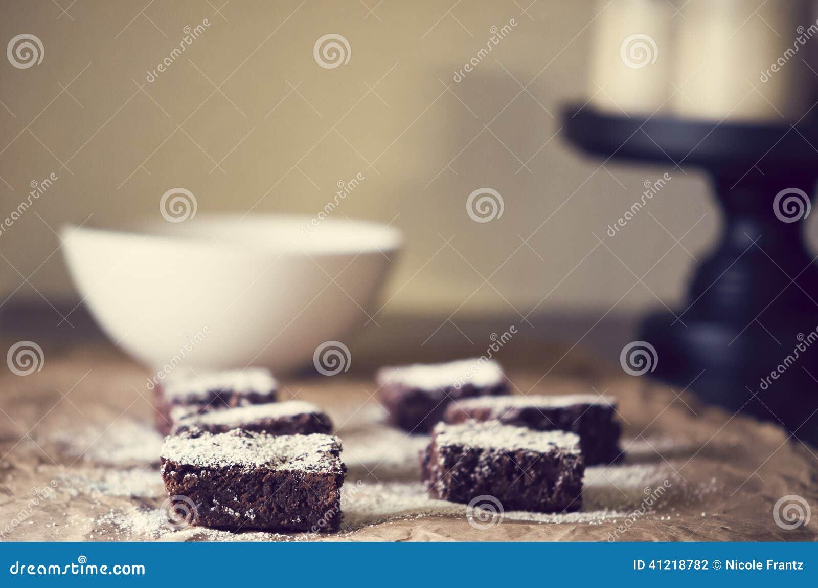 http://thumbs.dreamstime.com/z/chocolate-fudge-brownies-powdered-sugar-brown-background-41218782.jpg