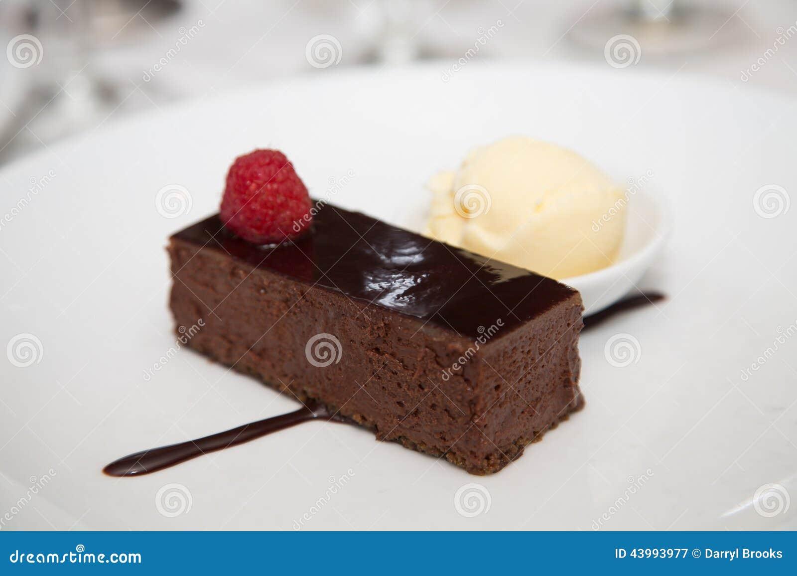 Chocolate Fudge Dessert With Raspberry And Ice Cream Stock