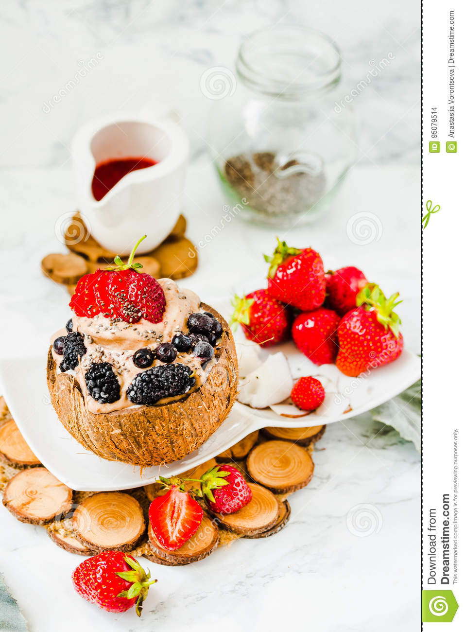 Chocolate ice cream with berries on coconut cup.Healthy vegetari