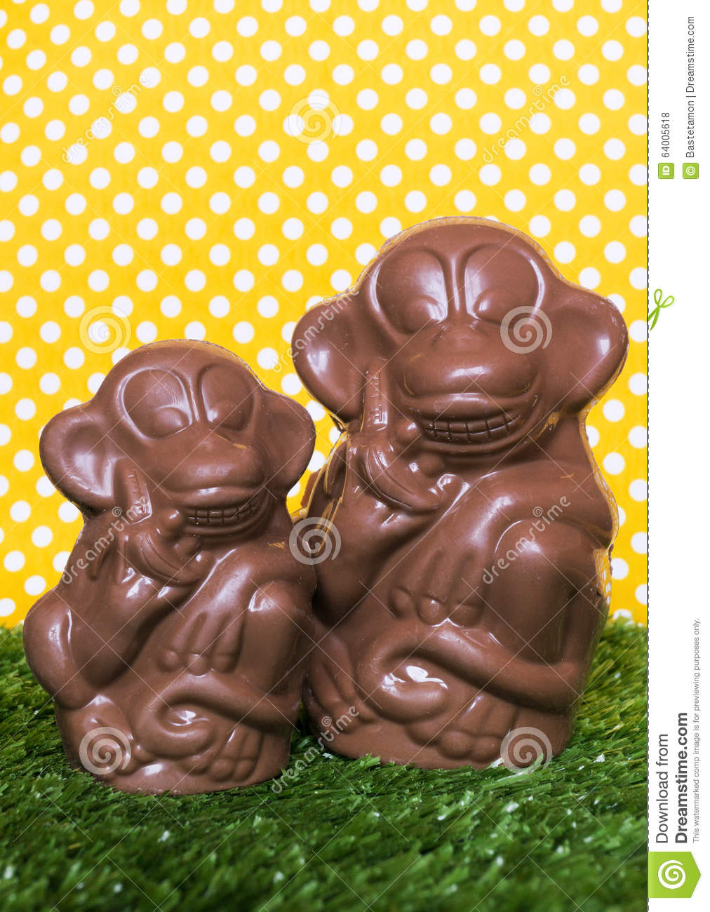 Chocolate Monkey On The Grass Stock Photo - Image: 64005618